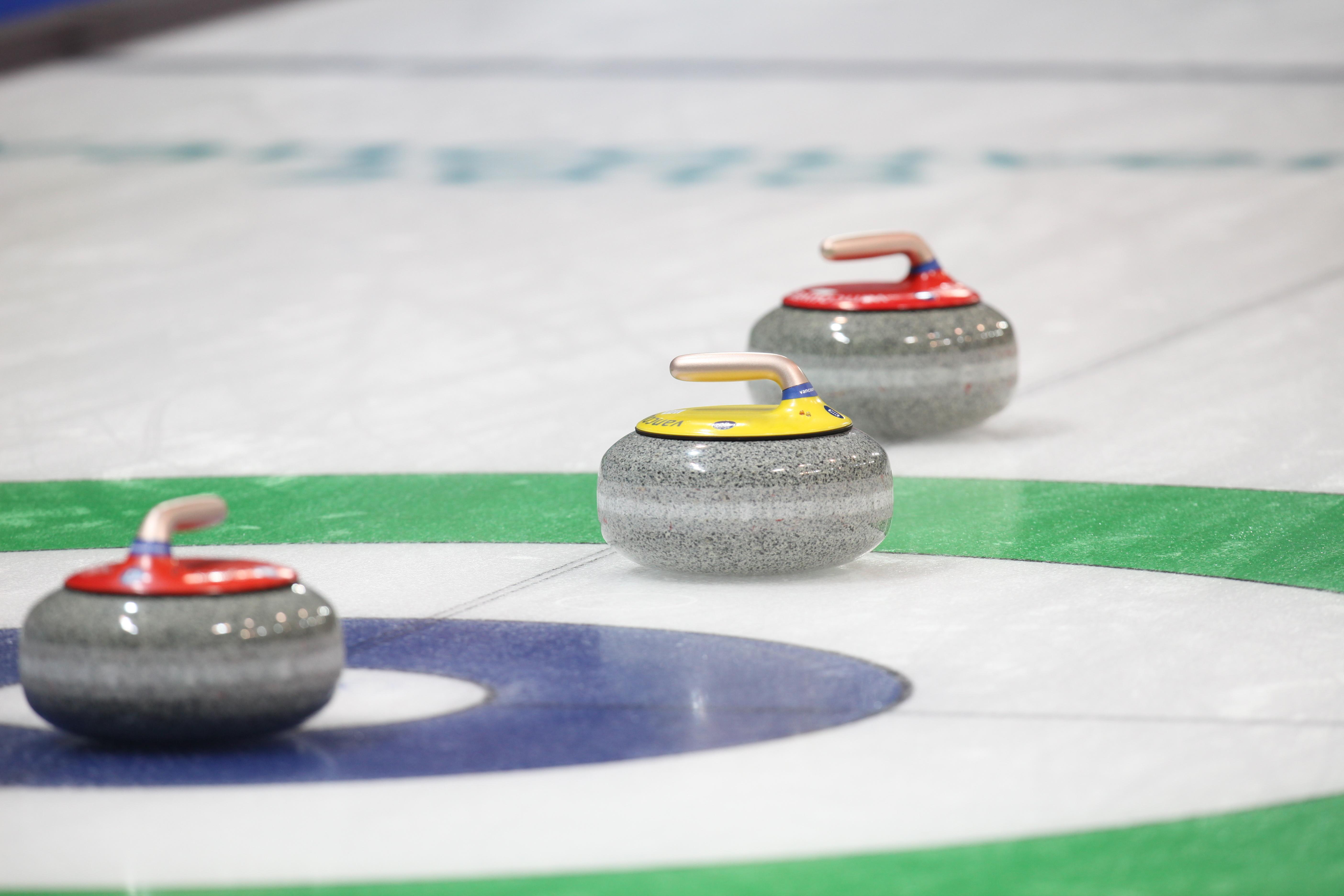 Three curling stones