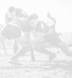 Rugby players battling for the ball.