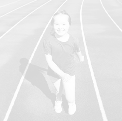 Young girl running on a track.