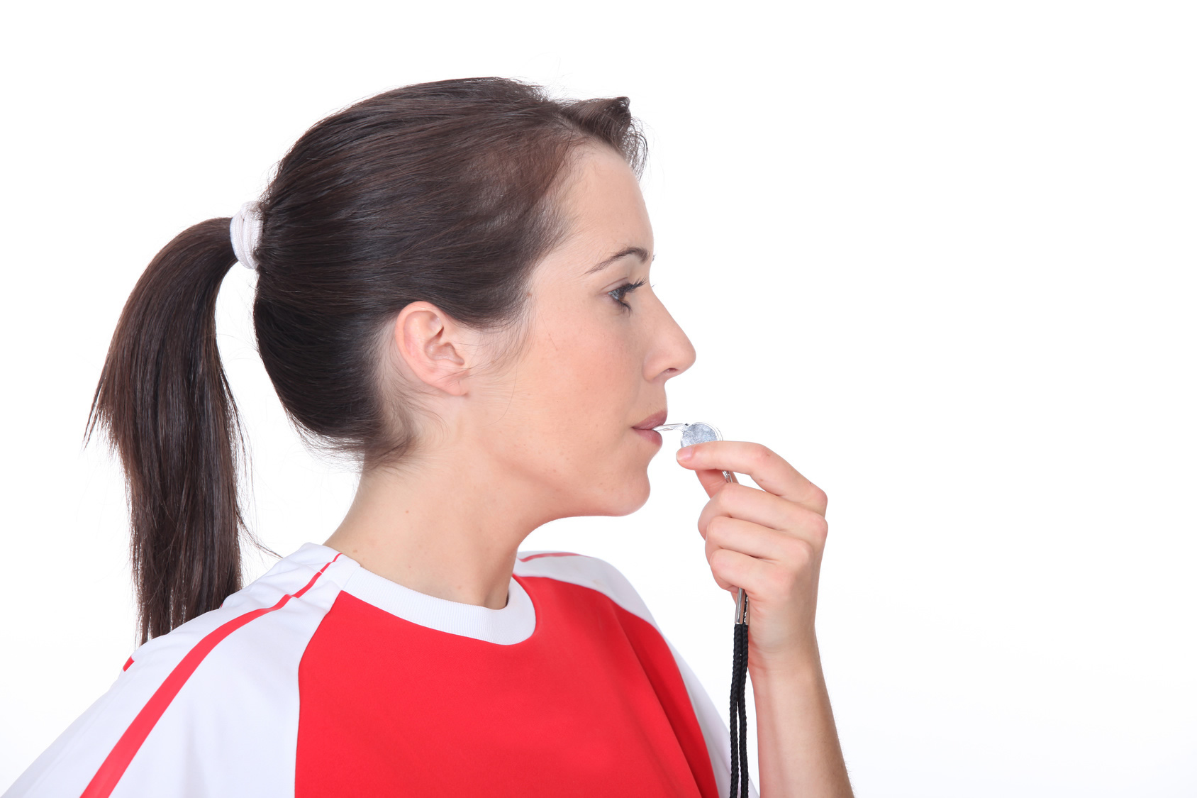 Female coach whistling.