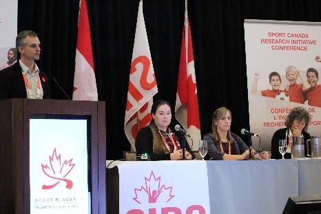 Speaker on stage at SCRI Conference