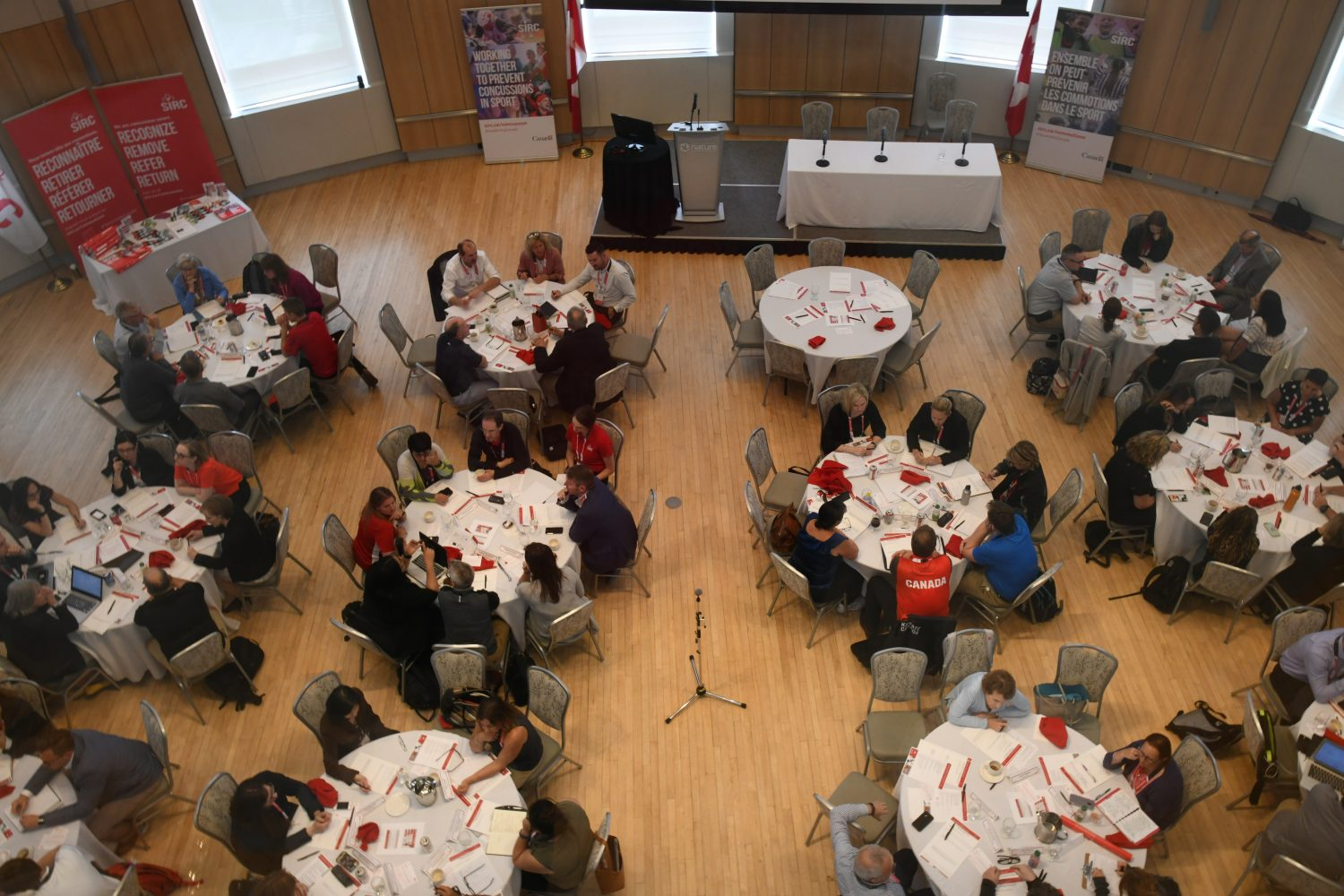 Birdseye view of round table discussions at a local conference.