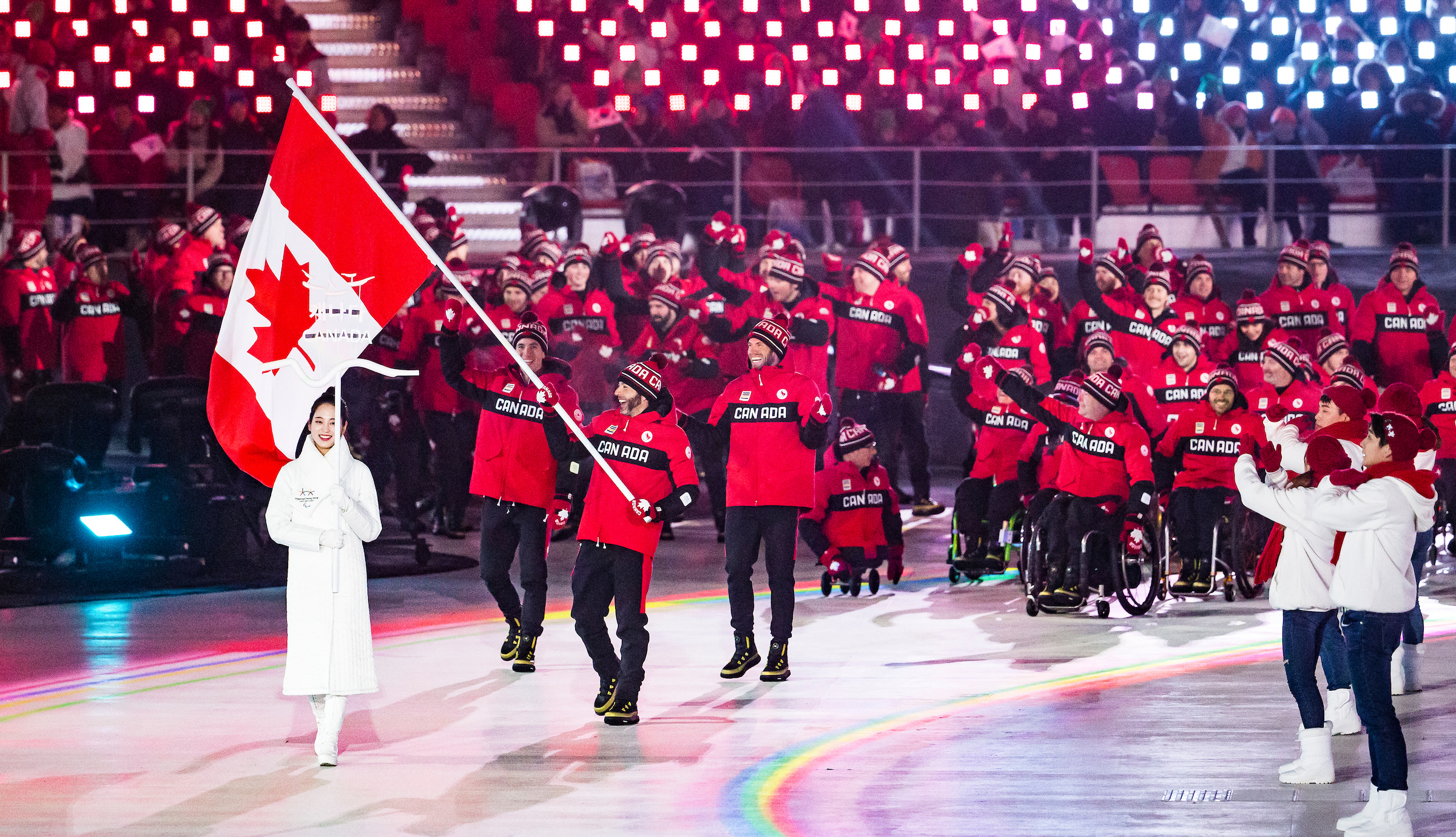 Canadian Paralympians walking in opening ceremony procession.