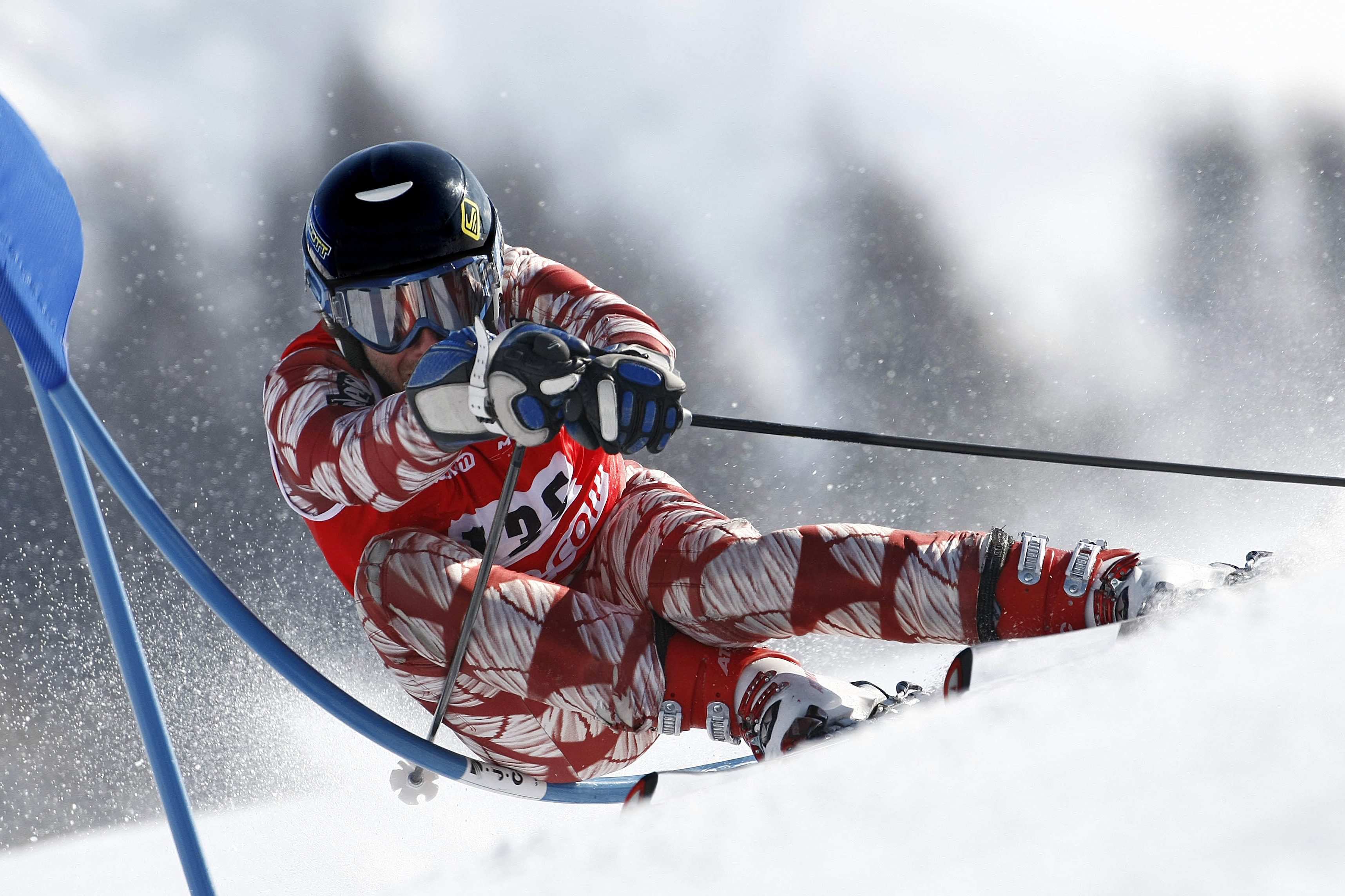 male alpine skier making a turn