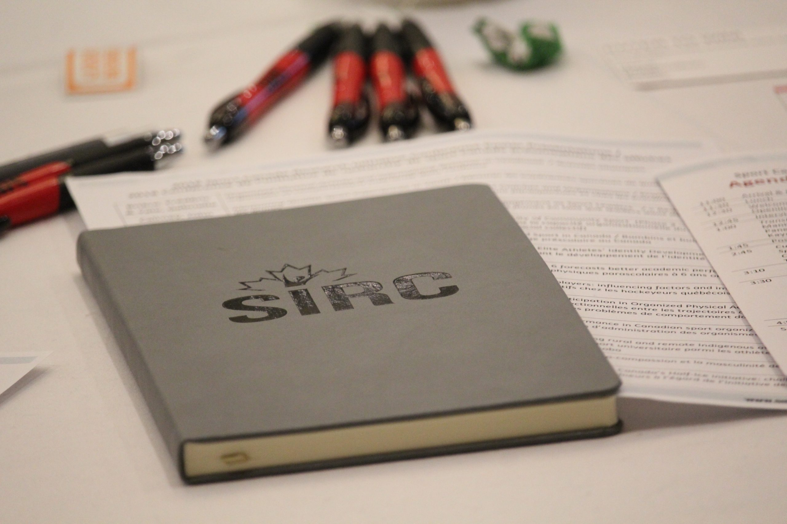 SIRC notebook and pens