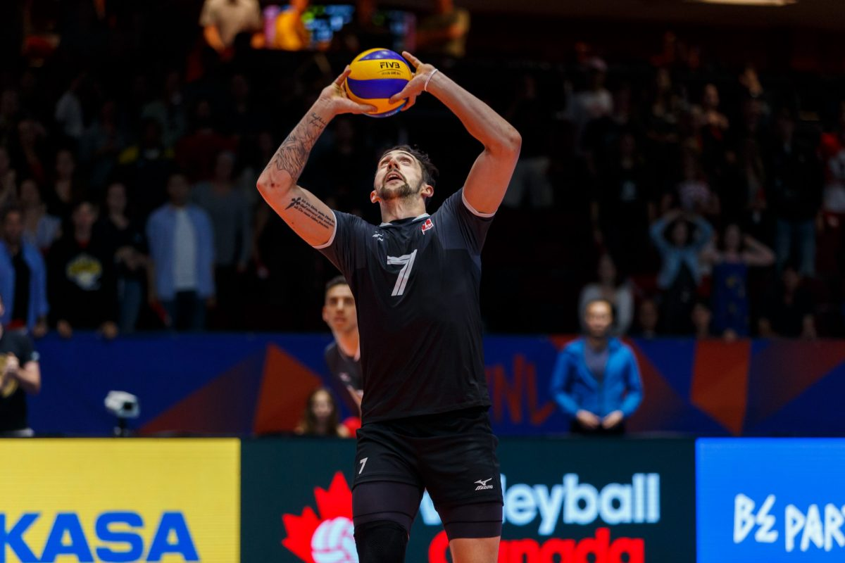 Male volleyball athlete preparing for a serve