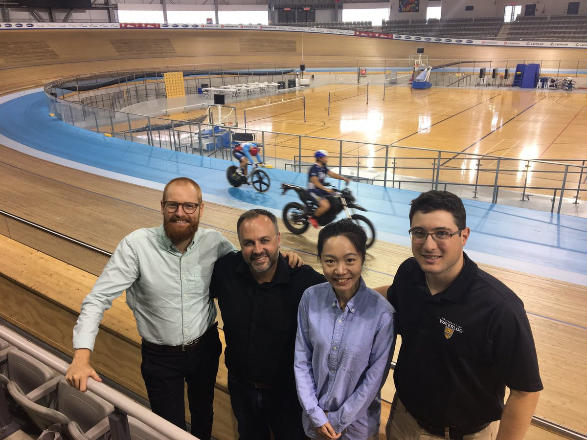 Four people at an indoor cycling facility