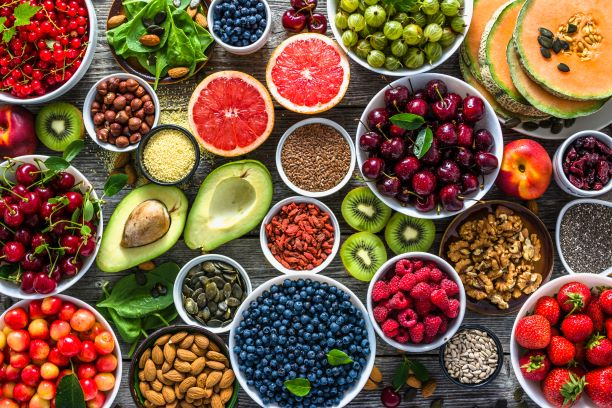 A table of healthy fruits, nuts and seeds