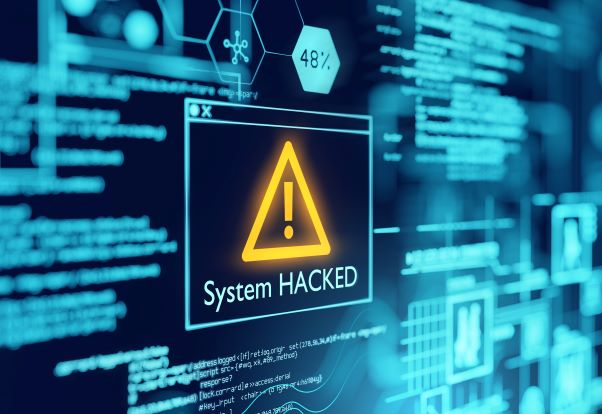 """A picture of a monitor with the message """"System hacked"""""""