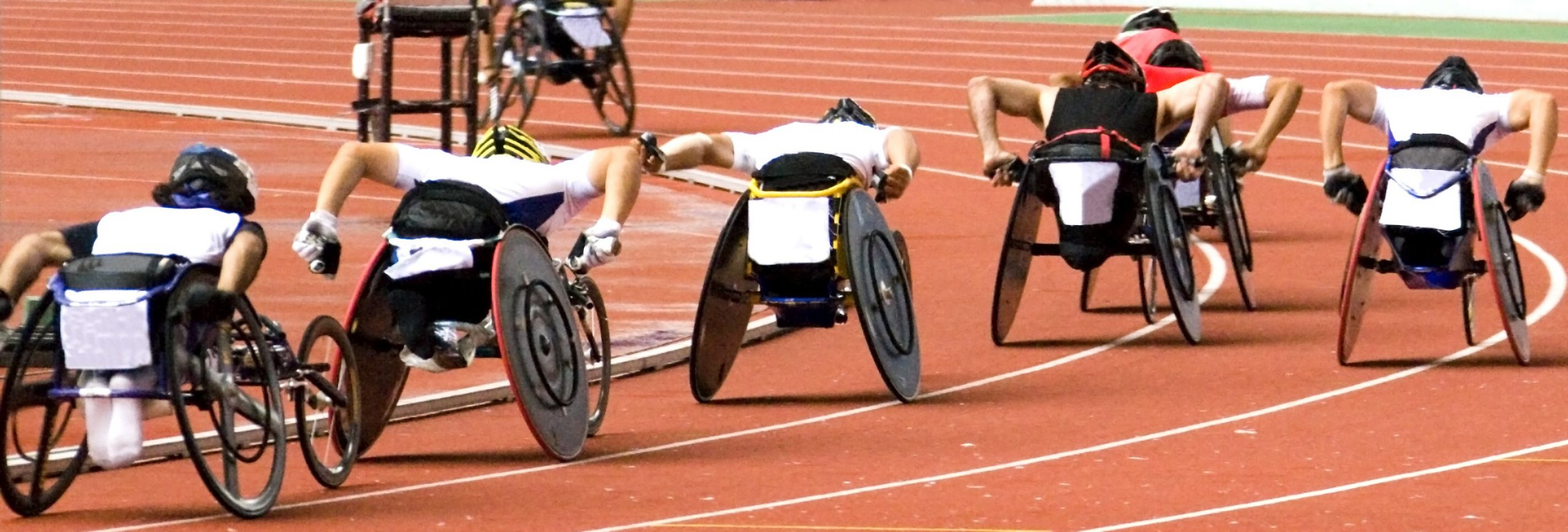 Wheelchair athletes competing on a track