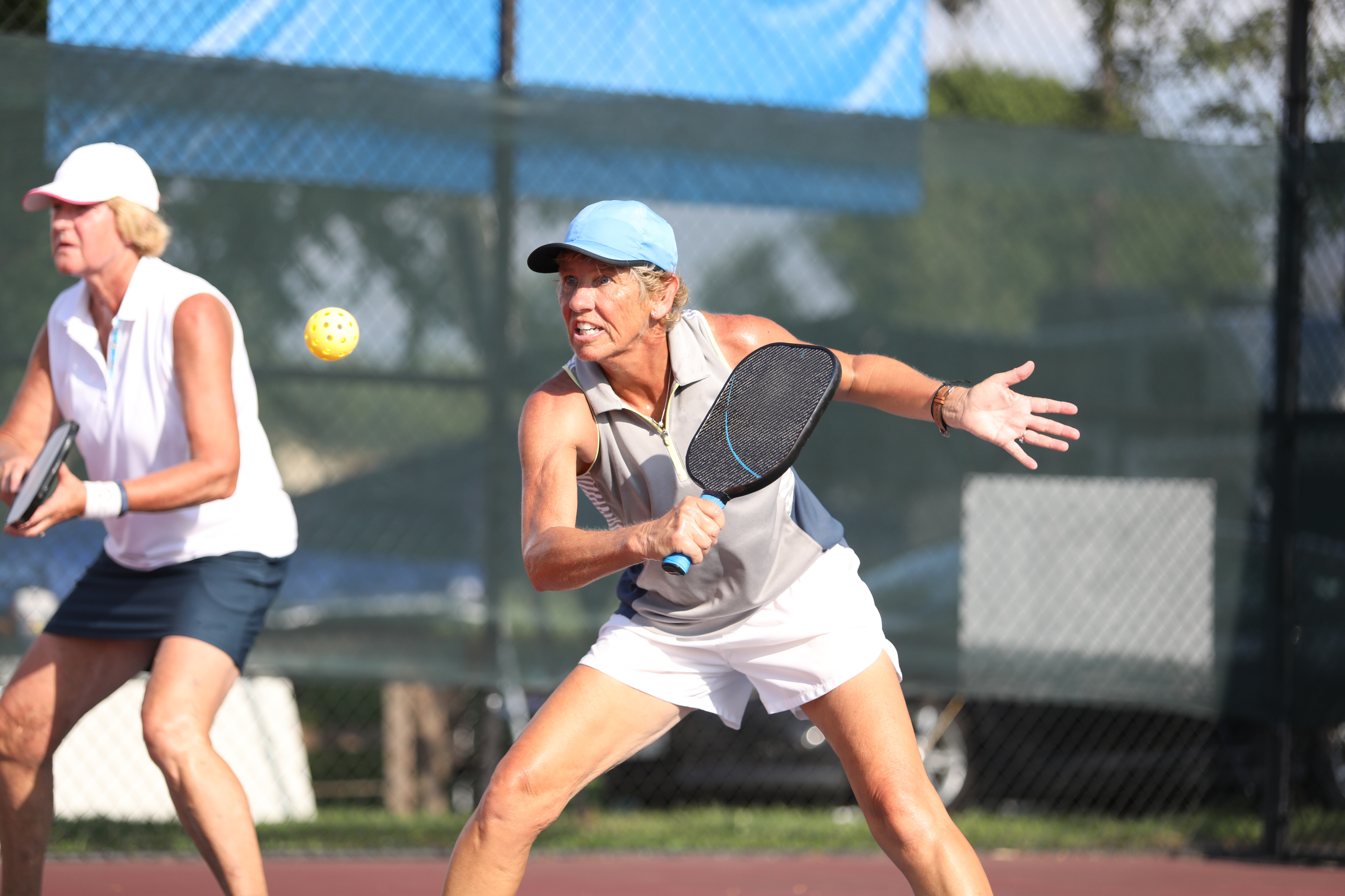Women playing pickle-ball