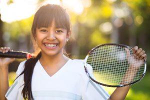 young girl holding a badminton racket, Outdoor