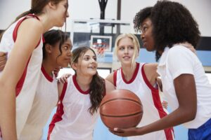 Female coach and youth basketball team