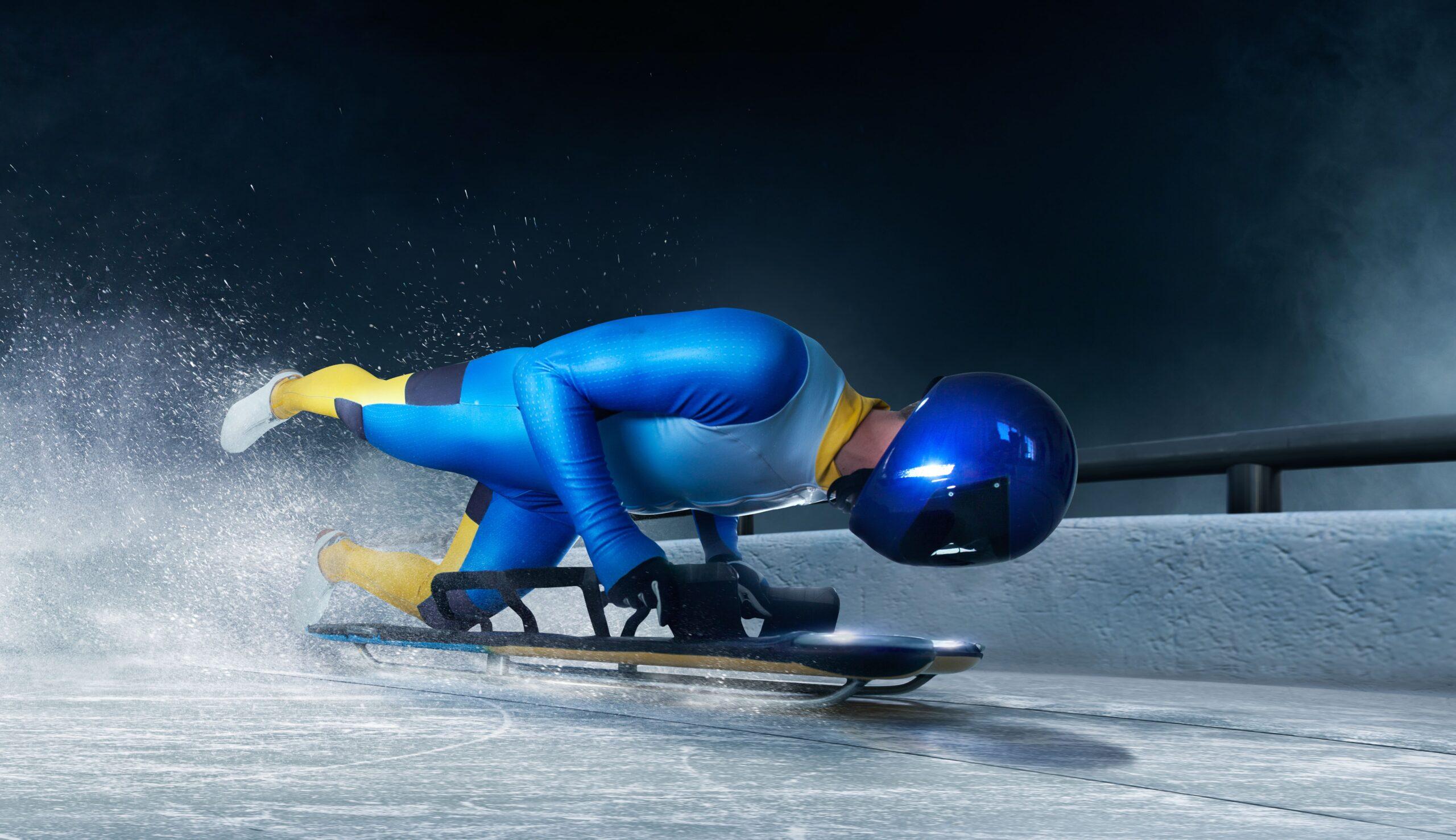 Athlete launching on to skeleton to start race.