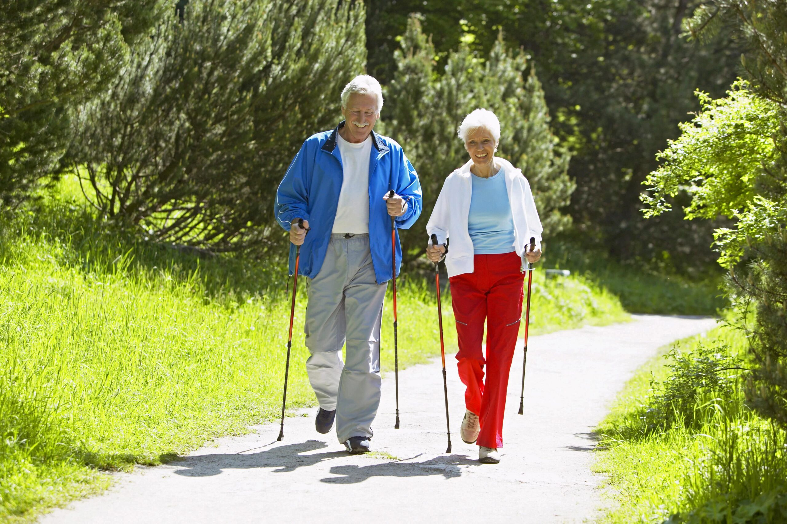 Senior couple walking on path.