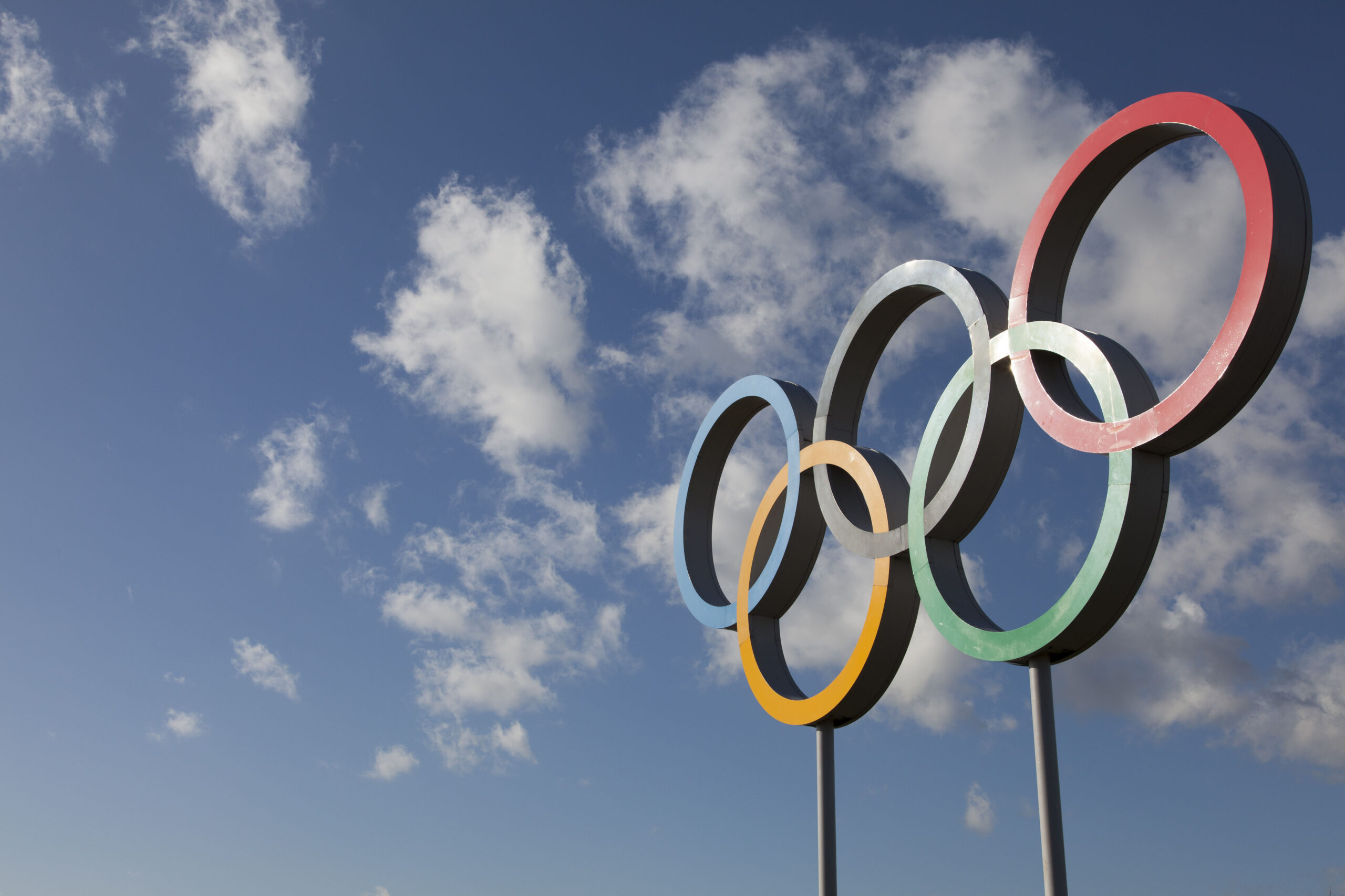 Olympic rings with bright blue sky behind