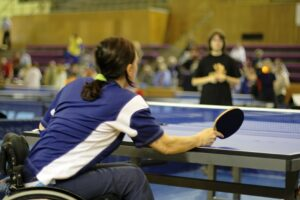 Female athlete with a disability playing table tennis