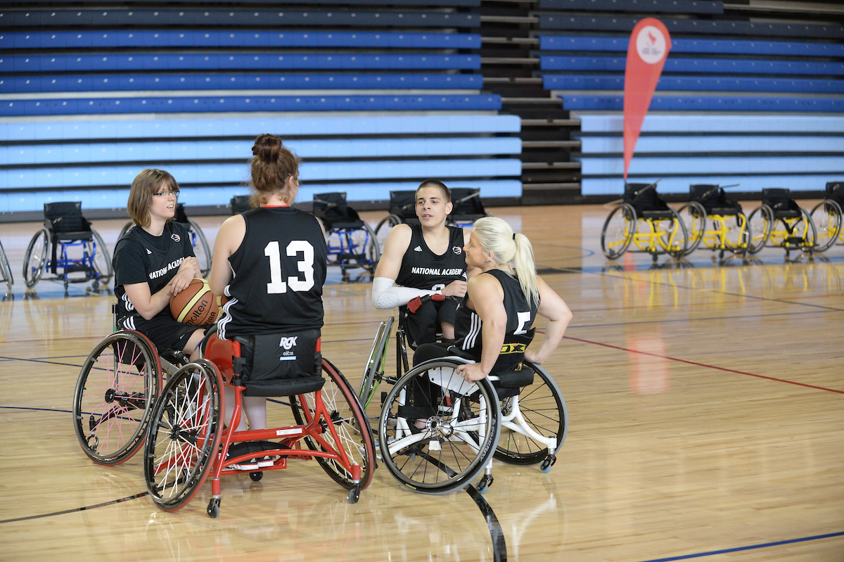 Womens wheelchair basketball players having a conversation