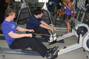 APEX participant and trainer using rowing machines together