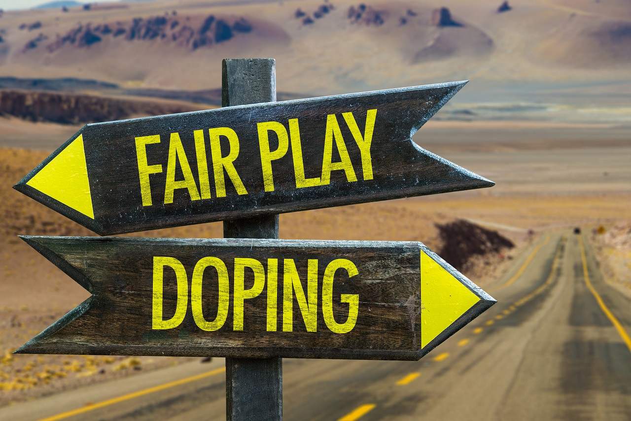 Sign with two arrows pointing opposite directions (Fair Play and Doping).