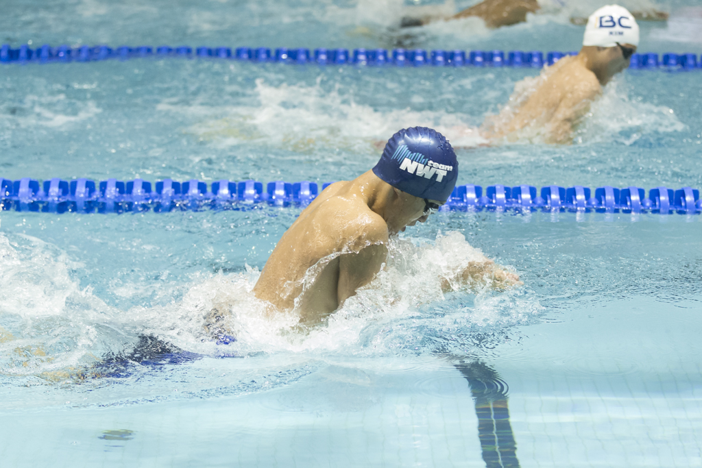 Swimmer wearing a swim cap from team NWT