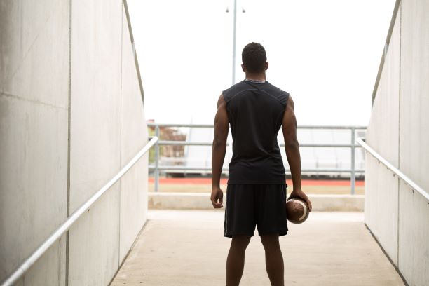 rear view of black football player