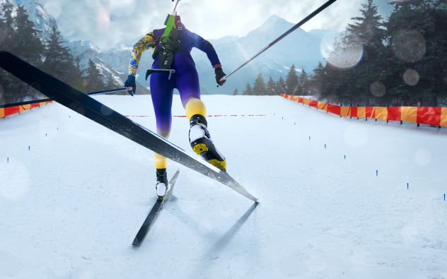 Female biathlete skiing toward finish line