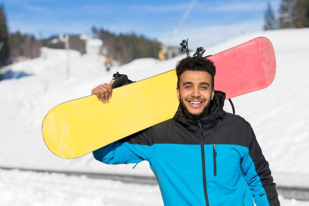 Hispanic Man Hold Snowboard Ski Resort Winter Snow Mountain Cheerful Happy Smiling Guy Holiday Extreme Sport Vacation