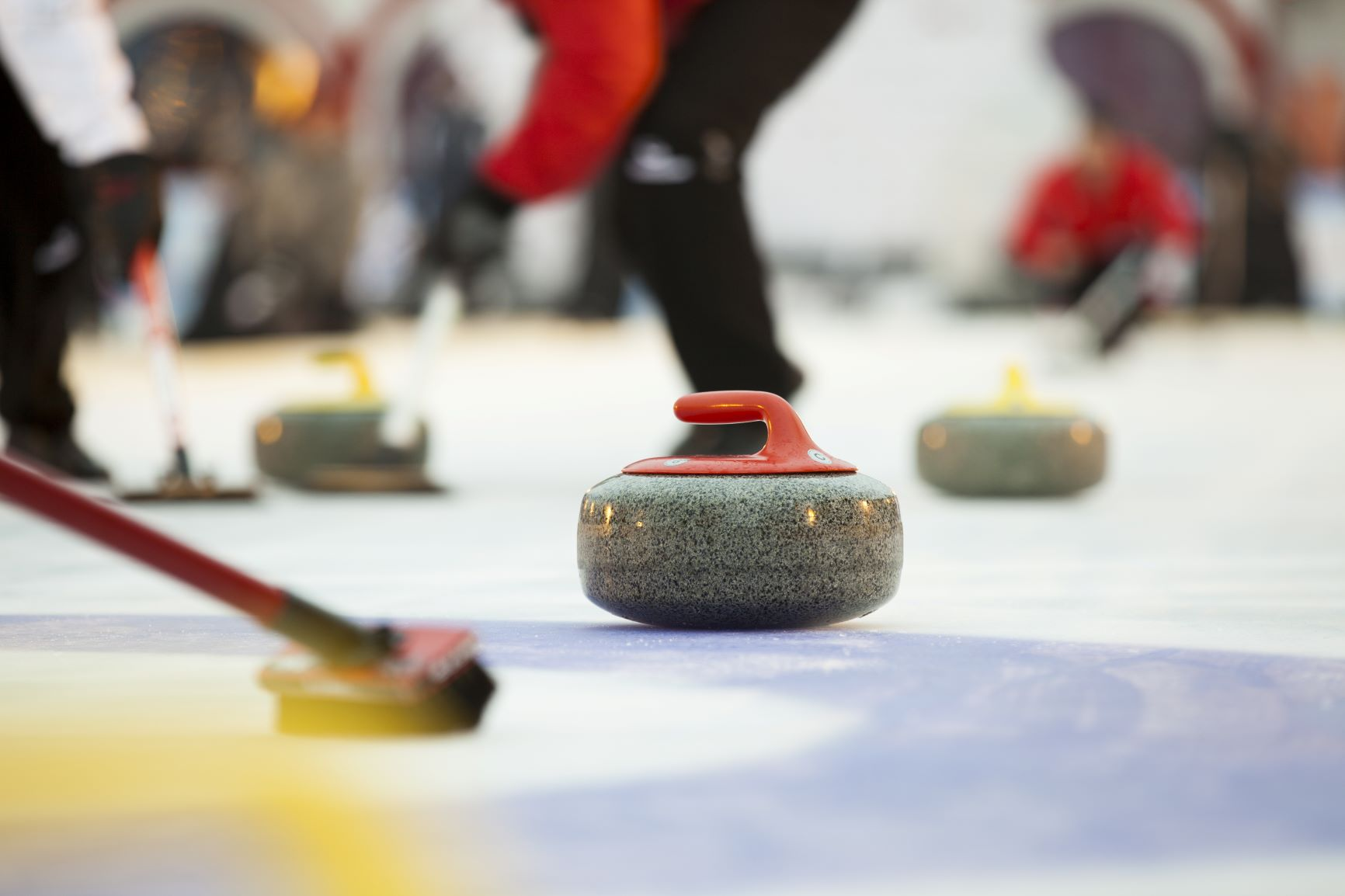Curling athletes competing.