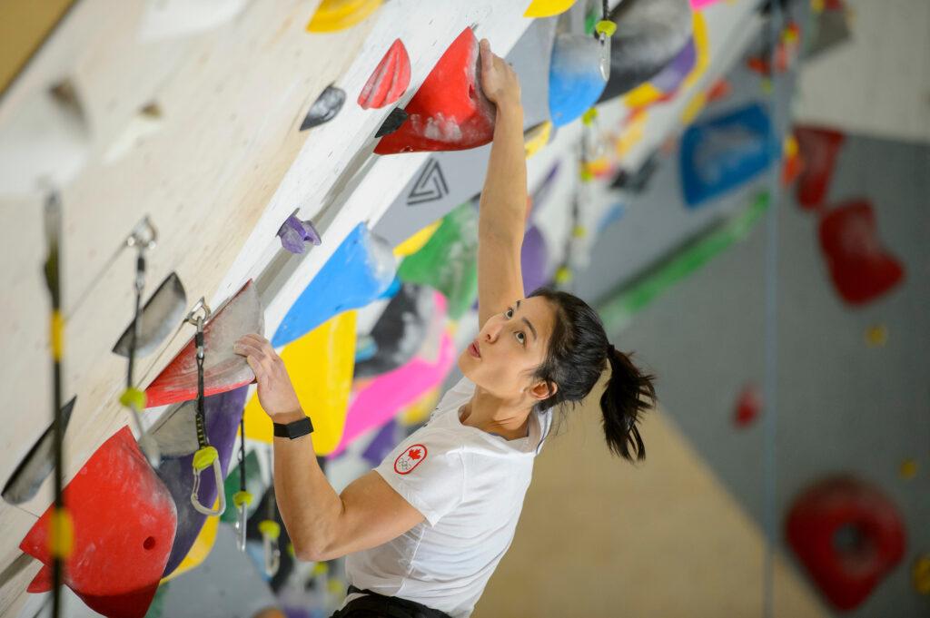 Photo of Alannah Yip climbing a rock wall