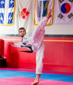 Photo of Para taekwondo athlete Anthony Cappello making a high kick