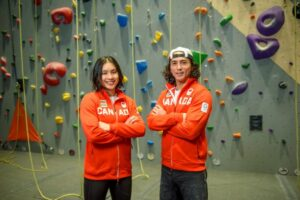 Photo of National Team athletes Alannah Yip and Sean McColl standing together with arms crossed in Canada gear