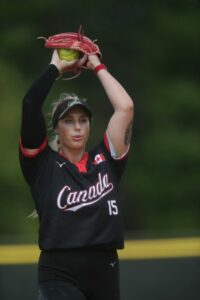 Photo of athlete Danielle Lawrie pitching a softball