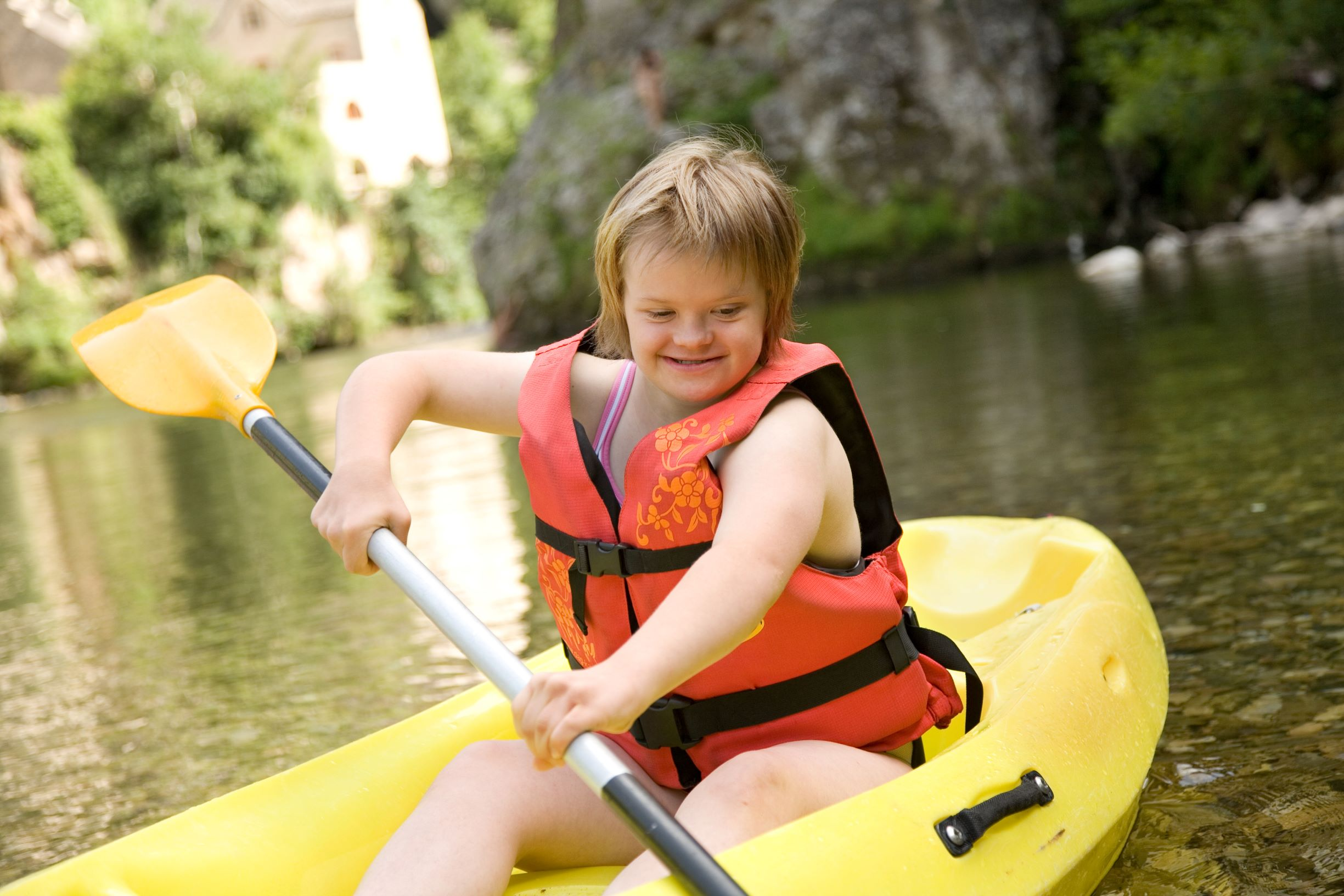Young girl with Down syndrome in a canoe