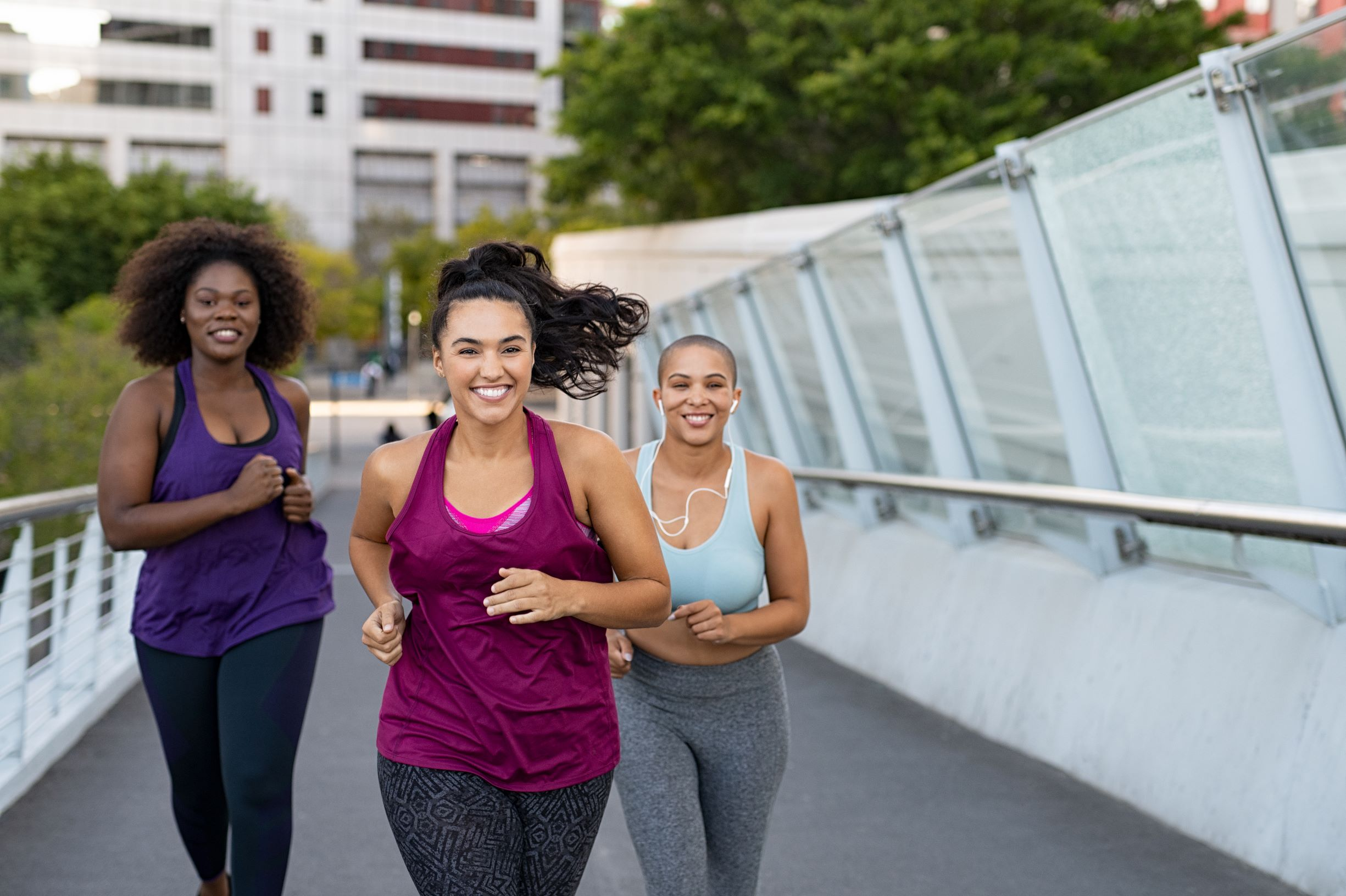 Group of women jogging together outside.