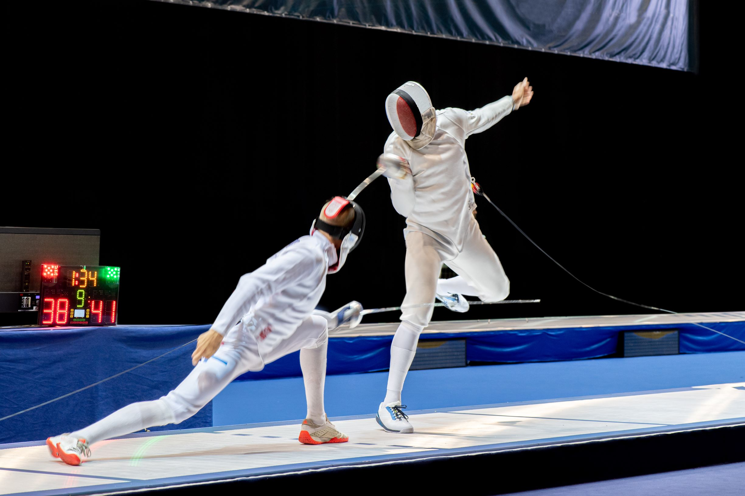 Licensed FILE #: 297263442 Preview Crop Find Similar Fight at a fencing competition.