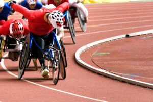 Para-athletics race. Closeup view of leading athlete during a race on the track.