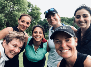 Group of women golfers smiling and taking a selfie. Members of Iron Lady Golf.