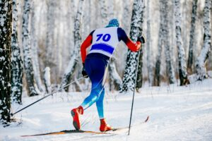 Nordic ski racer moving in classic style during competition.