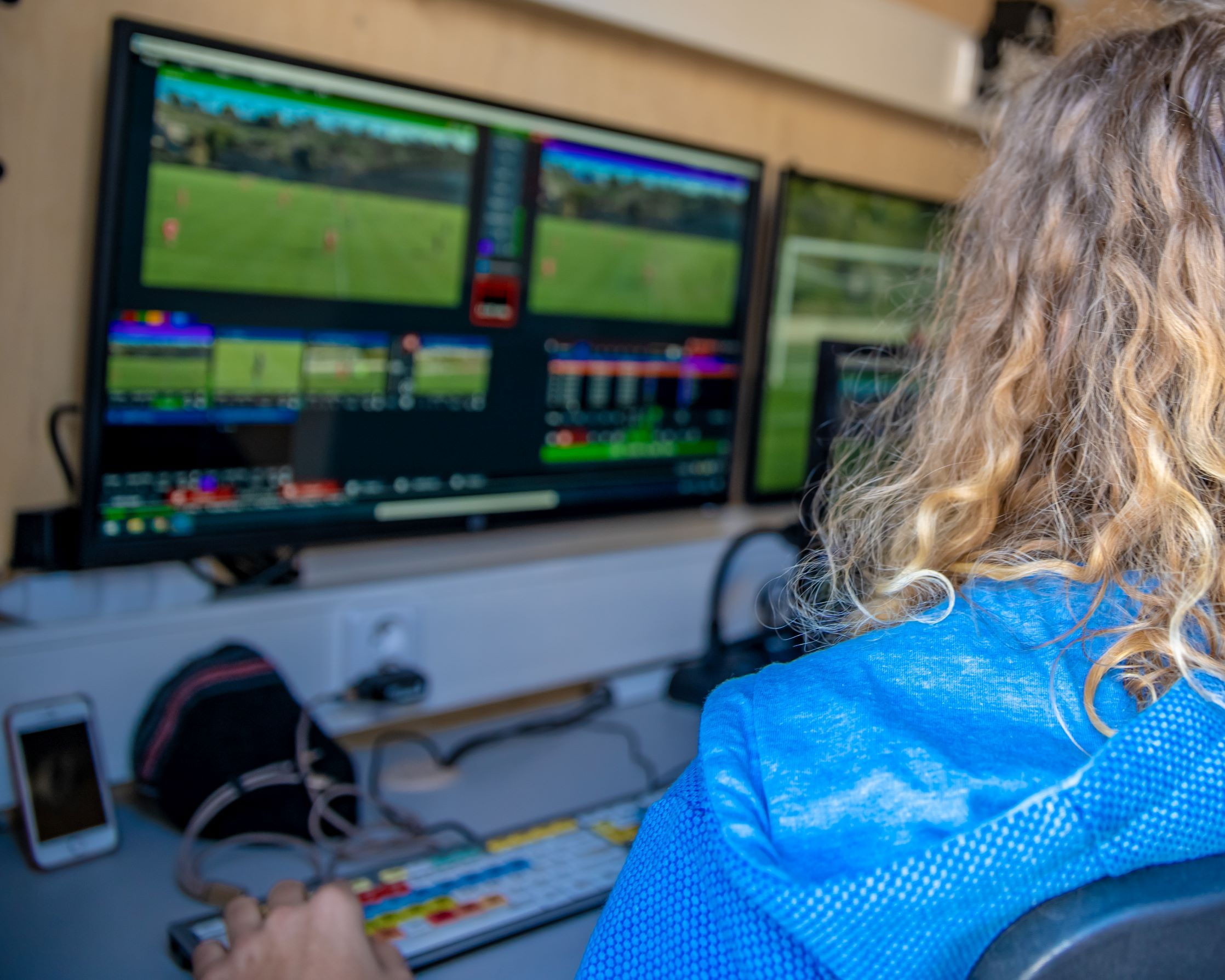 A behind the scenes look at a women working to broadcast a live sport event.