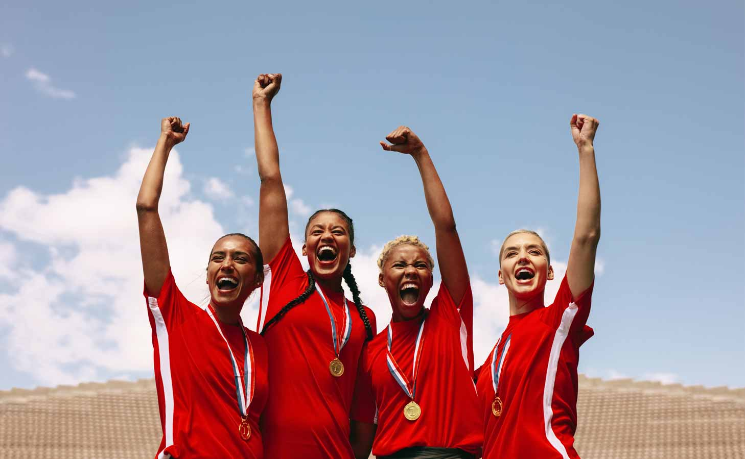 Professional female soccer players celebrating a victory